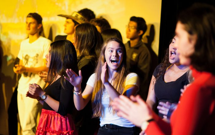 students dance and sing during global summit