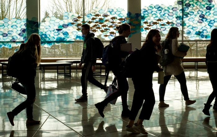 high school students move through the lobby of the Language and Performing Arts Center