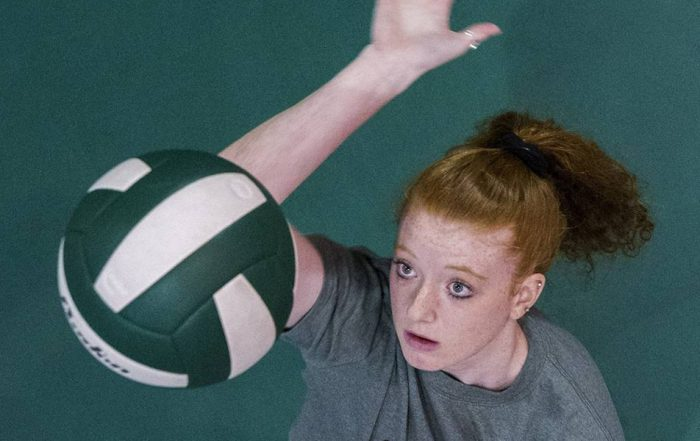 Abbie Jackson '19 getting ready to spike volleyball
