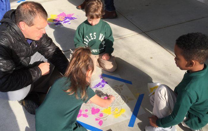 Associate Head of School Greg Bamford creating artwork with Junior Kindergarteners for Diwali