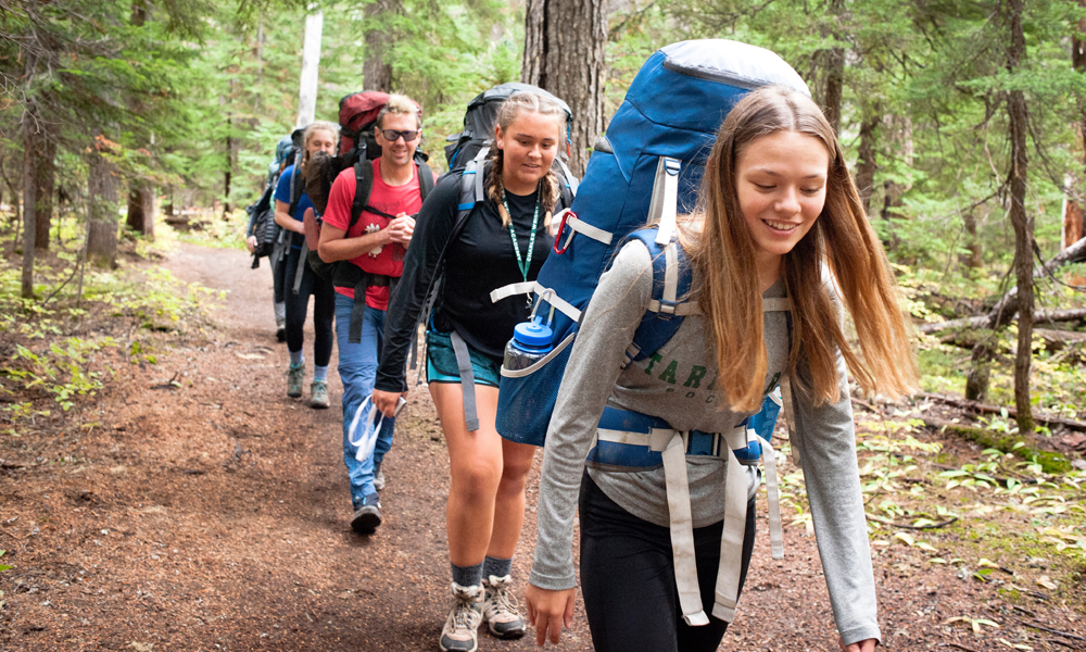 Students hiking with backpacks during Sophomore Outdoor Ed week