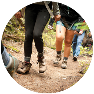 Hikers walk along a trail during sophomore outdoor ed week