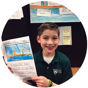 A 2nd grader at a project fair