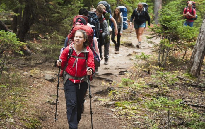 teacher Katie Miller leads group of Sophomore hikers through the woods