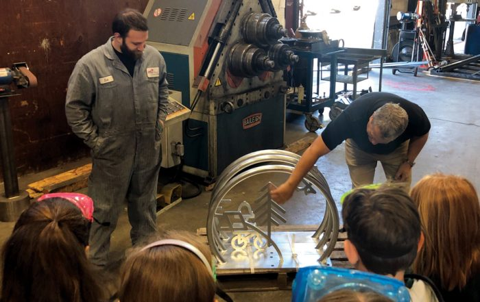 Fourth graders took a field trip to Specialty Metals to see how their design had been fabricated in galvanized steel