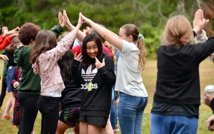 students participate in team building during middle school camp