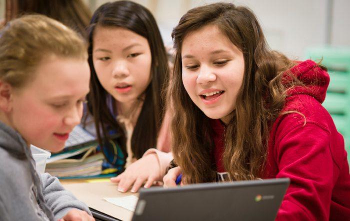 CWA student work on Chromebooks