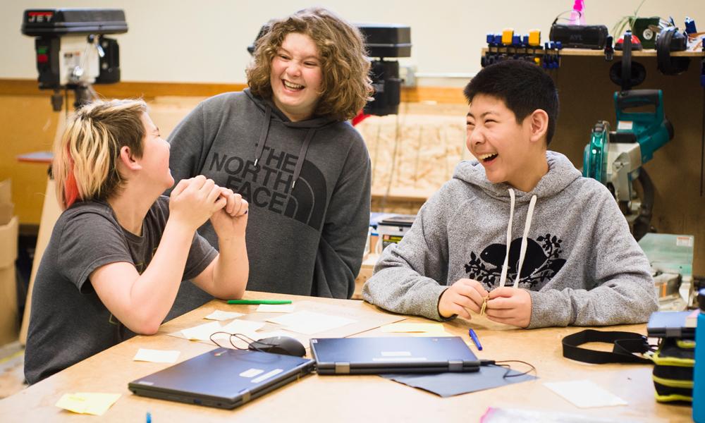 CWA students work with Chromebooks