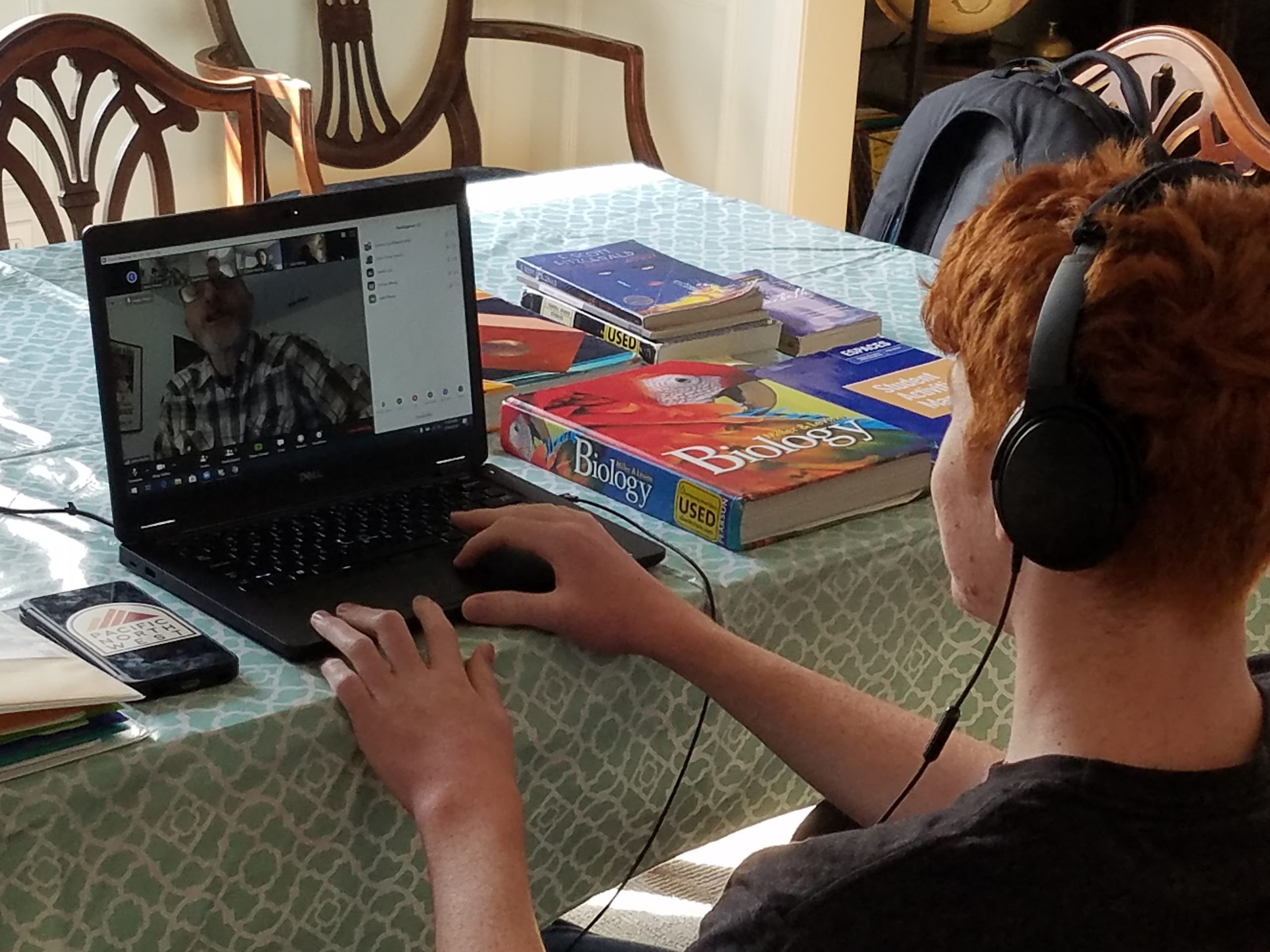 Upper School student Connor S. '23 at work during remote learning